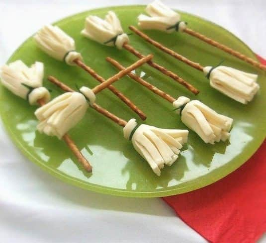 Witches broom snacks on green plate