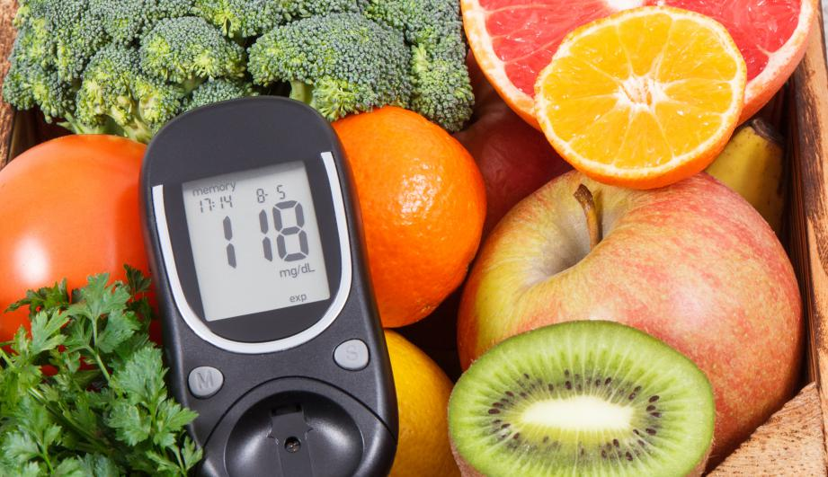 Glucometer with sugar level and natural fruits with vegetables. Diabetes and nutritious food containing minerals and vitamins