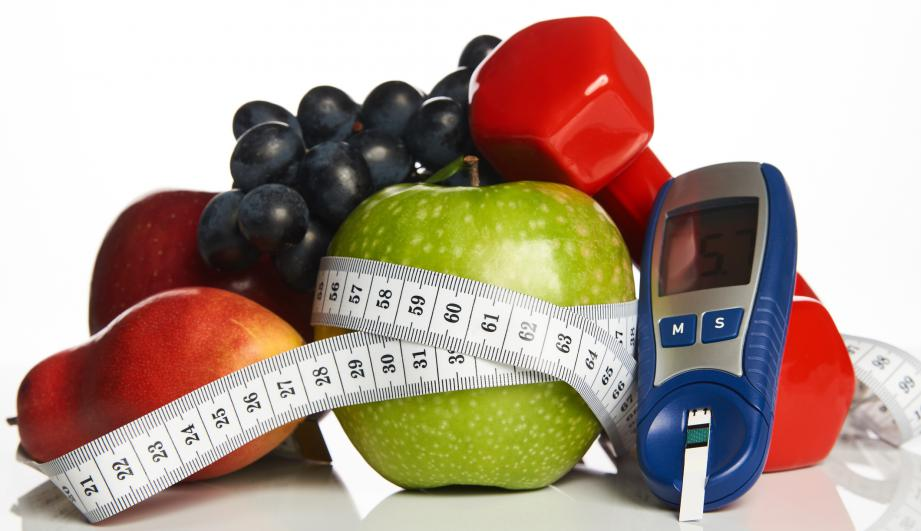 Blood sugar control with healthy organic food and dumbbells
