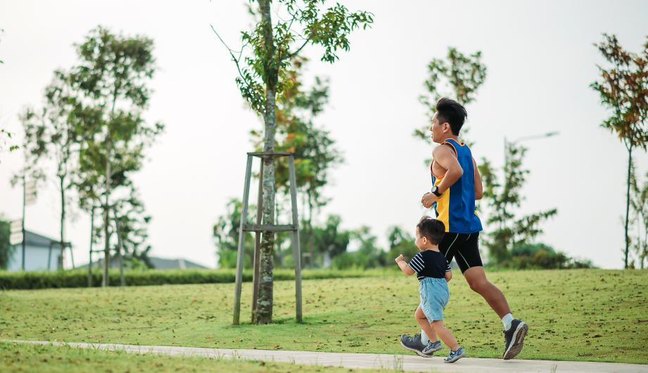 Man running in the morning with his son