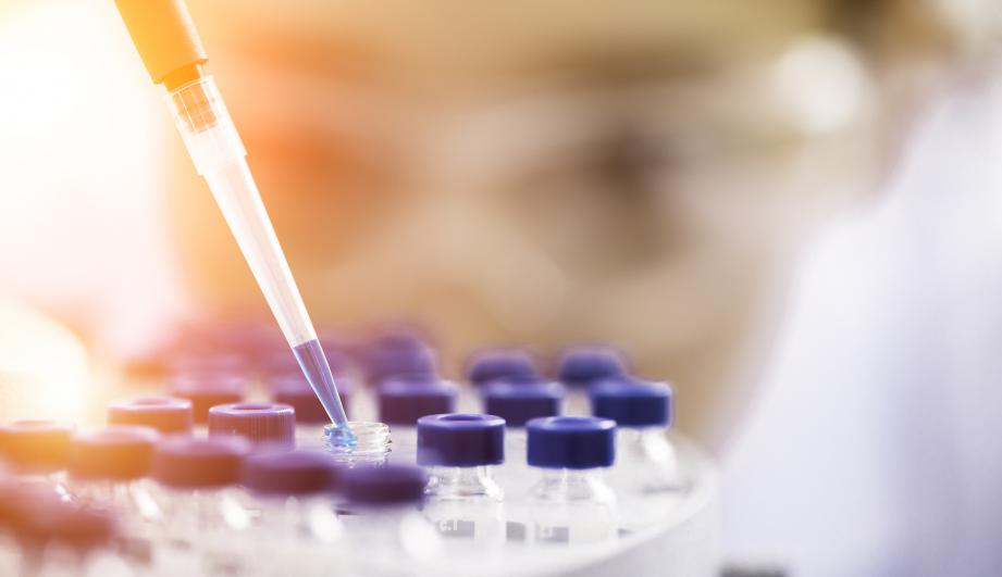 Female chemist at work in laboratory.