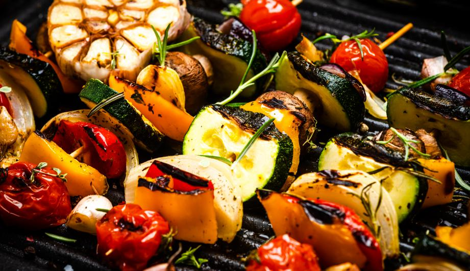 BBQ Grilled Wegetables on Skewers with Fresh Herbs and Spices. Summer Barbecue Food.