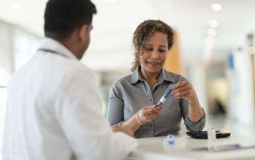 Diabetic patient meets with her doctor