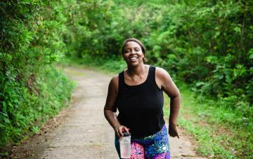 image of a woman running/exercising