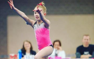 Audrina a pediatric patient does a gymnatics floor routine