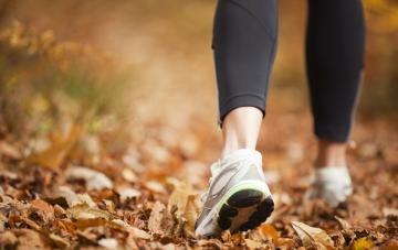 Walking in Fall Weather with a close up of woman's sneakers