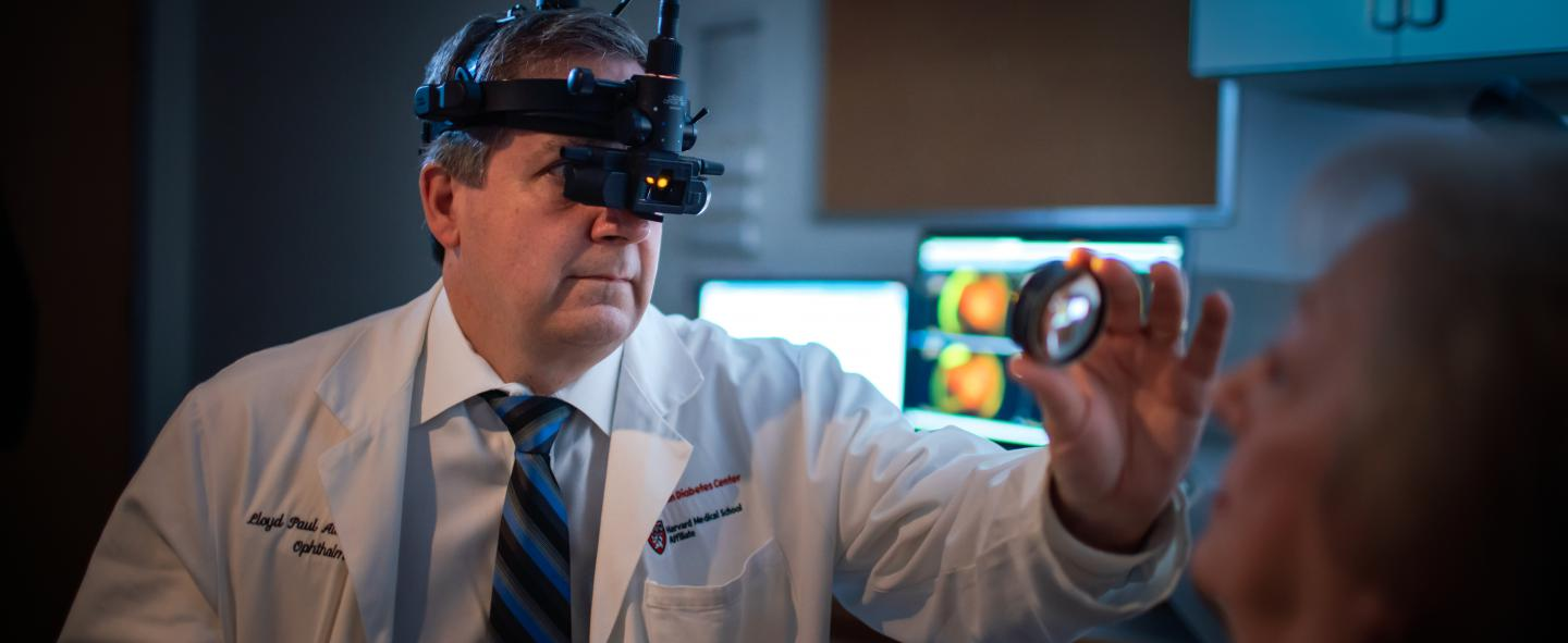 Dr. Lloyd Aiello, MD of the Beetham Eye Institute examining patient's eyes