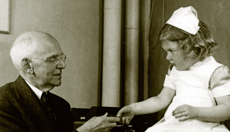 Elliott P. Joslin, MD with young patient