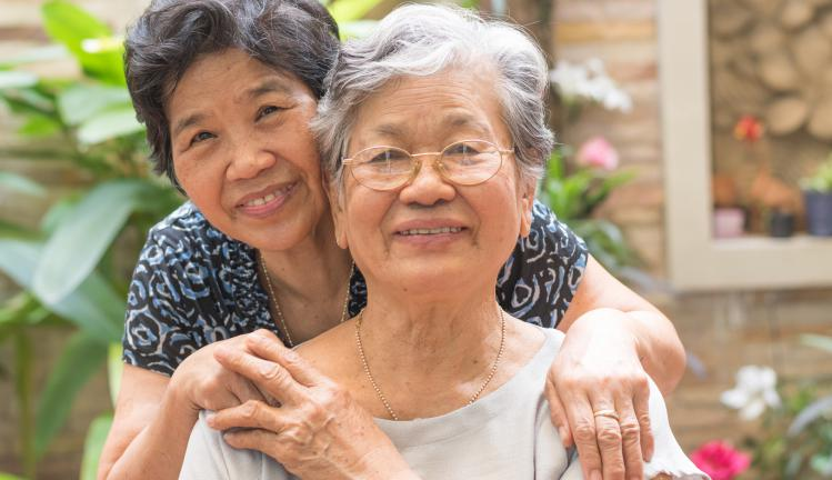 Asian female older ageing women smiling with happiness in garden at home