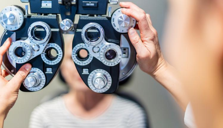 A close up of an optometrists phoropte during an eye exam.