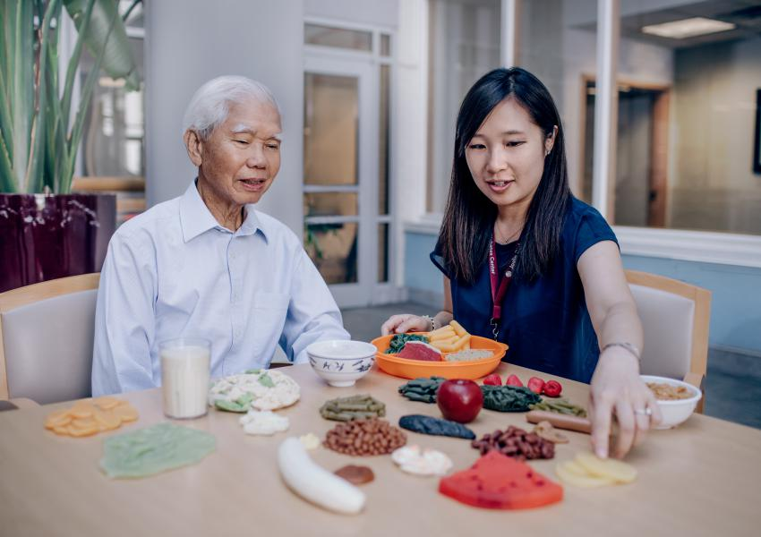 Diabetes Educator with Joslin AADI patient discussing nutrition.