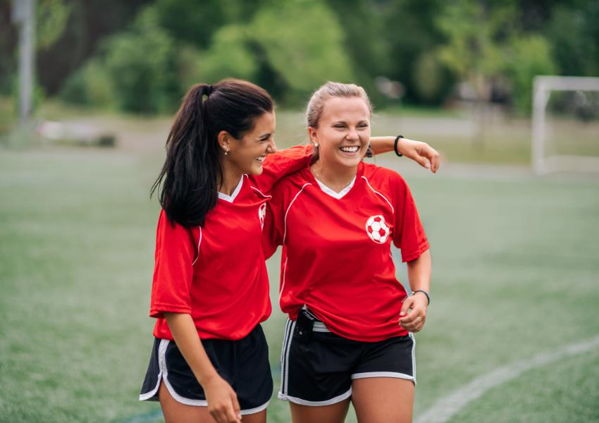 Joslin patient Catherine Scanlon and her friend walking off the soccer field after a game.