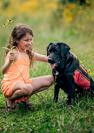 7-year-old Joslin patient Jillian Galvin with her diabetic service dog Epi.