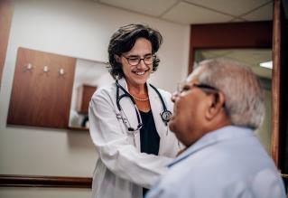 Joslin Doctor examining Joslin patient.