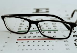 Eye test poster with glasses